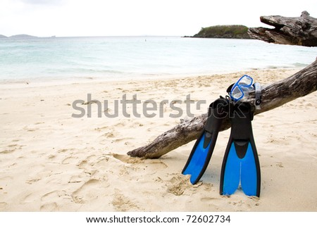 Snorkel gear on a sandy beach. - stock photo