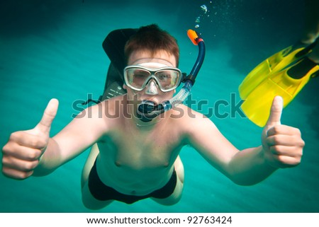 Snorkeler diving along the brain coral - stock photo