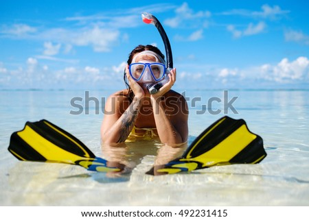 Snorkeler woman having fun on the tropical beach, Exuma, Bahamas