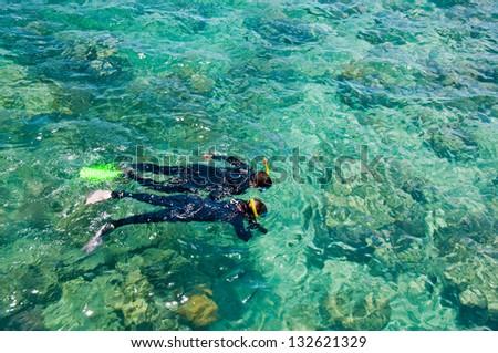 Snorkelers, Great Barrier Reef, Australia - stock photo