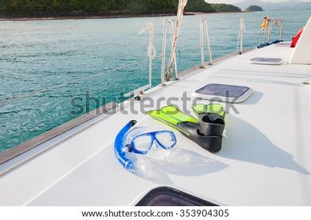 Snorkeling gears on the luxury yacht sailing in Phuket, Thailand - stock photo