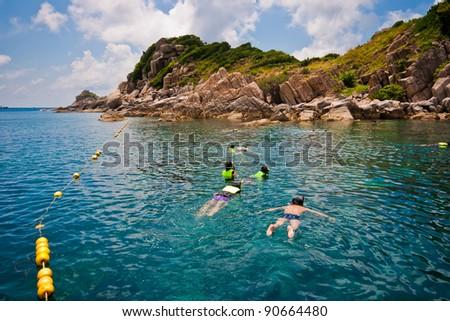 snorkeling in bay at Koh Samui, Thailand - stock photo