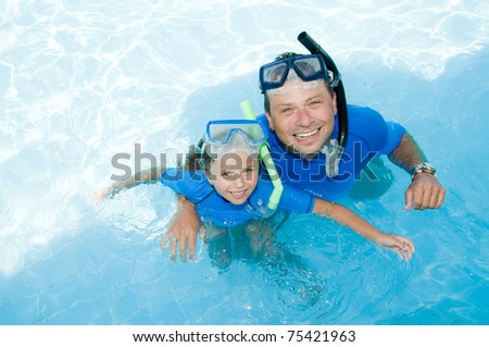Snorkeling in blue water - stock photo
