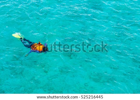 Snorkeling in tropical Maldives island