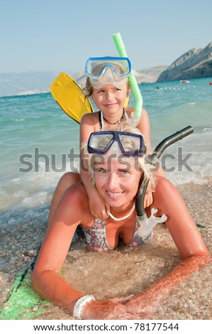 Snorkeling - little girl with mother ready for snorkeling