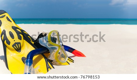 snorkeling set on the the beach - stock photo