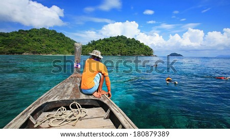 snorkeling spot to see coral reef at transparent crystal andaman sea in Surin islands national park, Thailand - stock photo