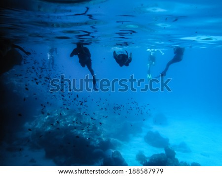 Snorkelling and Kayaking around the Blue room cave  Curacao Caribbean - stock photo