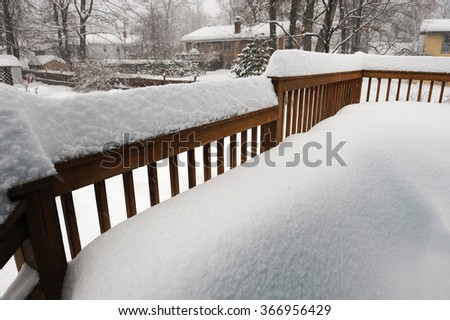 snow accumulated on the deck after heavy snow storm - stock photo