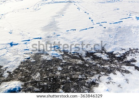 snow and ice at frozen lake in cold winter day - stock photo