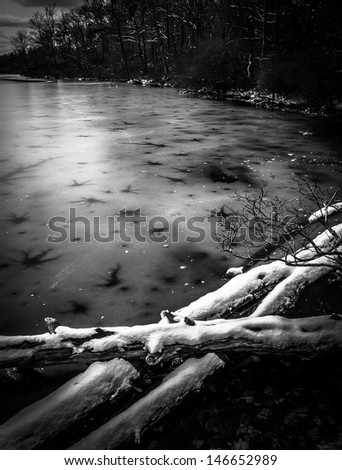 Snow and ice on Sunfish Pond, along the Appalachian Trail in Delaware Water Gap National Recreational Area, New Jersey - stock photo