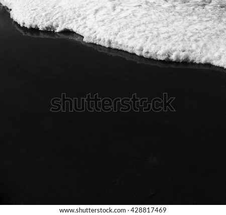 Snow and ice with water. Black and white abstract background. - stock photo
