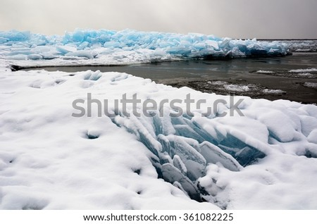 Snow and Plate Ice on Lake Superior in Minnesota - stock photo
