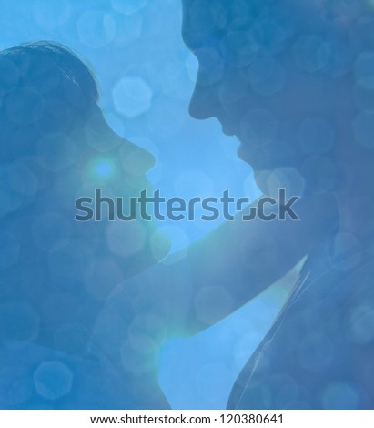 Snow and stars are falling on the background of blue luminous ra - stock photo