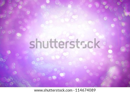 Snow and stars are falling on the background of violet luminous - stock photo