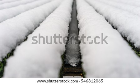 Snow at a wooden bench pattern