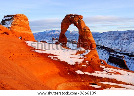 Snow at Delicate Arch at Arches National Park in Utah - stock photo