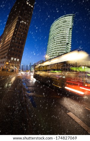 snow at potsdamer platz in berlin - stock photo
