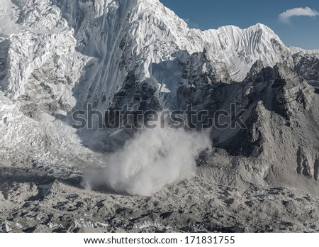 Snow avalanche falls from the slope of the Nuptse (7864 m), view from Kala Patthar - Nepal, Himalayas