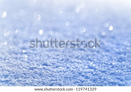 Snow background removed in kontrovy light by means of a monocle. - stock photo