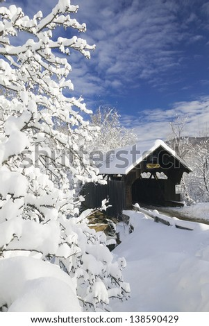 Snow blanketed Emily's covered bridge in Stowe Vermont, USA - stock photo