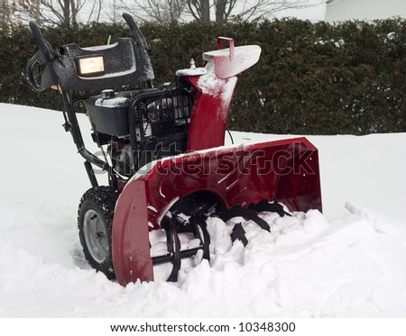 snow blower in the snow in winter - stock photo