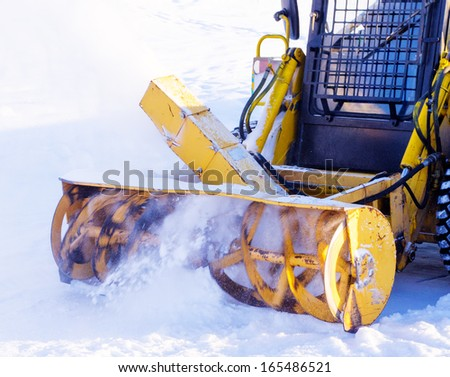 Snow blower removes snow from the tracks. - stock photo