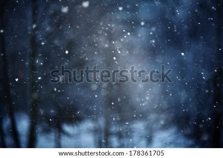 snow bokeh texture on black background - stock photo