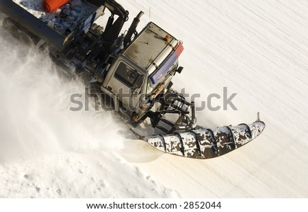 snow buldoser from above - stock photo