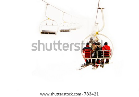 snow cableway with three people in cabin