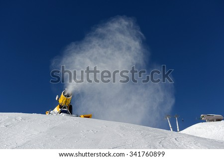 Snow cannon making snow at ski resort - stock photo