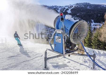 Snow cannon, snow powder making on the ski slope Nassfeld, Austria, with Backlit splashing