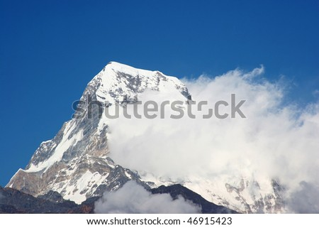 snow-cap Annapurna peak with whirling clouds, nepal