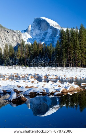 snow capped half dome at yosemite national park - stock photo