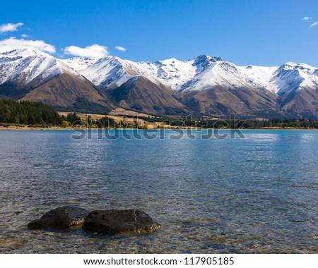 Snow capped mountain and Lake Ohau South Island New Zealand - stock photo