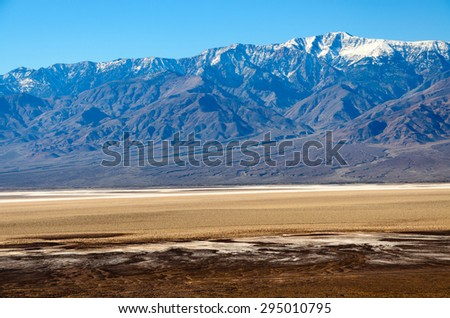 Snow Capped Mountain at Death Valley - stock photo