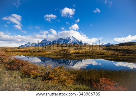 snow capped mountain at mirror lake in Autumn