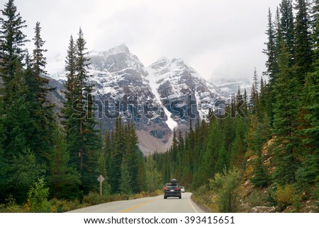 Snow capped mountain of Banff National Park and highway in Canada - stock photo