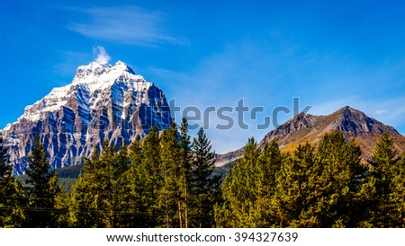 Snow capped mountain peaks in Yoho National Park in the Canadian Rocky Mountains under blue sky - stock photo
