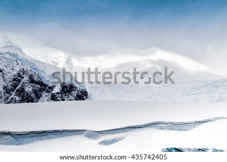 Snow capped Mountain ranges near Errera Channel in Antarctica - stock photo