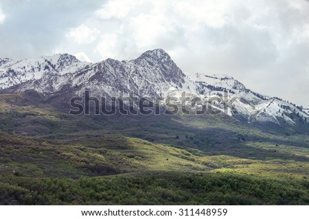 Snow capped mountain used for skiing and winter sports in norther utah  - stock photo