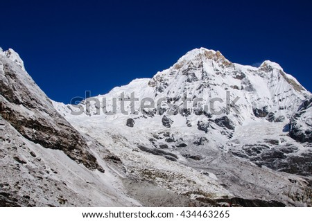 Snow capped mountains in Annapurna Sanctuary, Nepal in pre-monsoon season. Annapurna is a massif in the Himalayas.