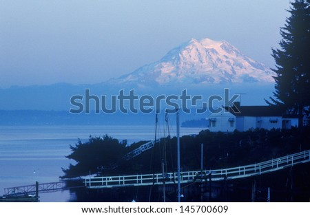 Snow-capped Mt. Rainier seen from Seattle, WA - stock photo