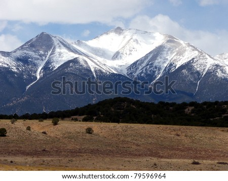 Snow capped peaks and high desert during Spring in the Colorado Rocky Mountains