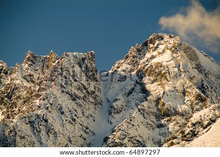 Snow capped peaks with sharp ridges on mountains