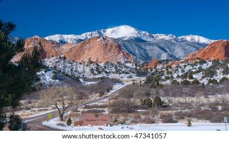 Snow capped Pikes Peak in February soaring over the Garden of the Gods Park at Colorado Springs - stock photo