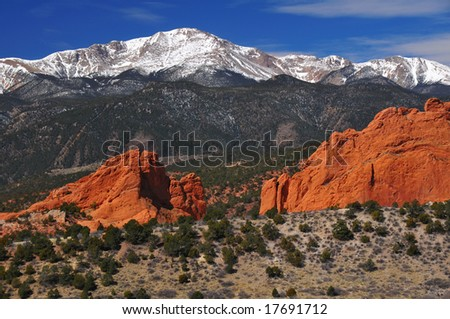 Snow Capped Pikes Peak Soaring over the Garden of the Gods near Colorado Springs, Colorado in Winter - stock photo