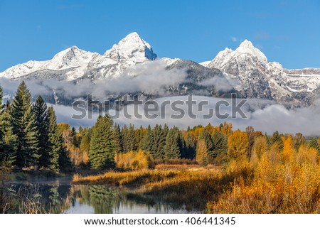 Snow Capped Tetons in Fall