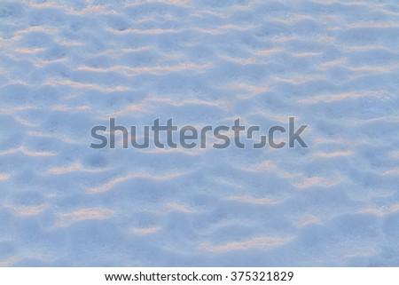 snow carpet at sunset  on the white snow  - stock photo