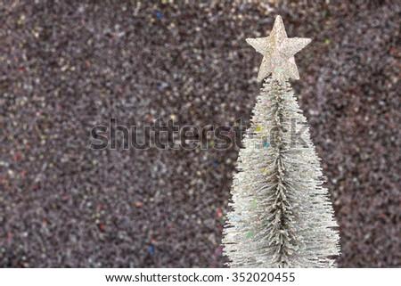 Snow christmas tree on glitter black background  - stock photo